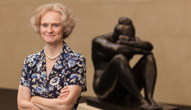 Laure de Margerie, Director of the French Sculpture Census poses with a sculpture by Aristide Maillol.