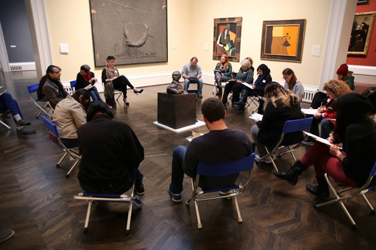 Teachers discuss art in the Meadows Museum galleries