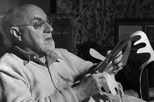Henri Matisse working on a paper cutout