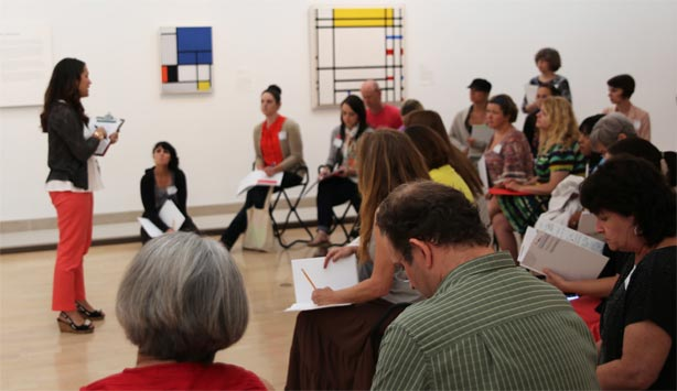 Teachers discuss paintings by Mondrian at the Dallas Museum of Art during Museum Forum for Teachers.