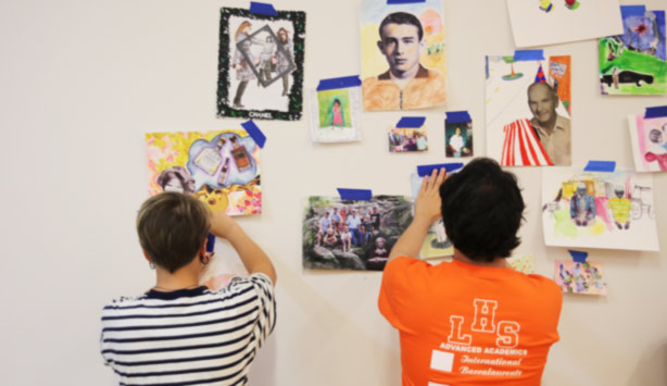 Students hang artwork