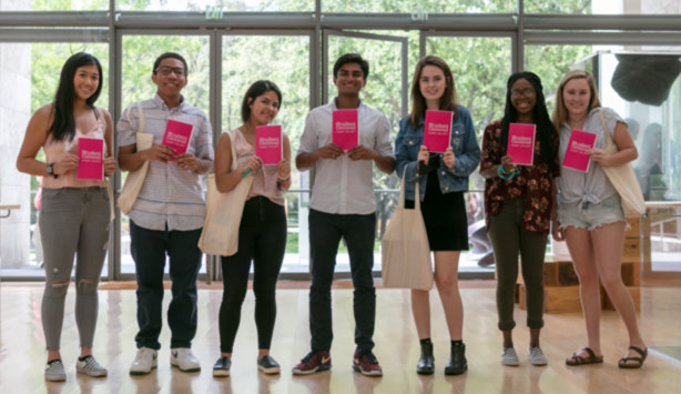 Students show off their copies of the Student-Centered zine.
