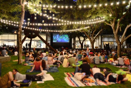 Attendees enjoy live music and a film screening in the Nasher Garden.