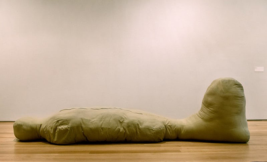 Fabric sculpture by Sterling Ruby titled 'Laying Figure'