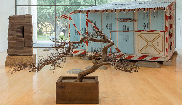 Image of an artistically rendered tree in front of a powder blue trailer