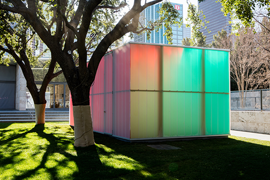 A multicolored box that is a sculpture by Ann Veronica Janssens titled 'Blue, Red and Yellow