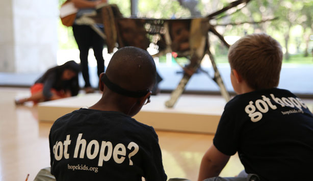 Two boys from HopeKids view sculpture by David Bates at the Nasher