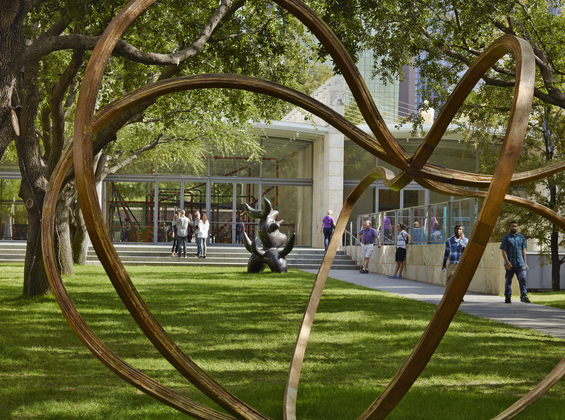 Visitors Walking In Nasher Garden With Artwork By Richard Deacon