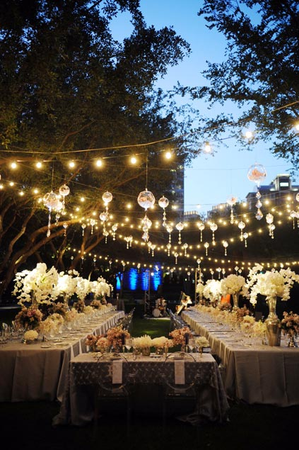 Tables And Le Lights In The Nasher Garden Under Backdrop Of Downtown Dallas At