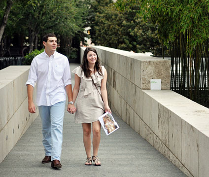 A couple enjoys a walk through the Nasher Garden